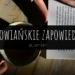 Otwarta książka leżąca na stole i kawa, obie przytrzymane kobiecymi dłońmi. Na świrdku napis graficzny: Słowiańskie zapowiedzi styczeń 2019