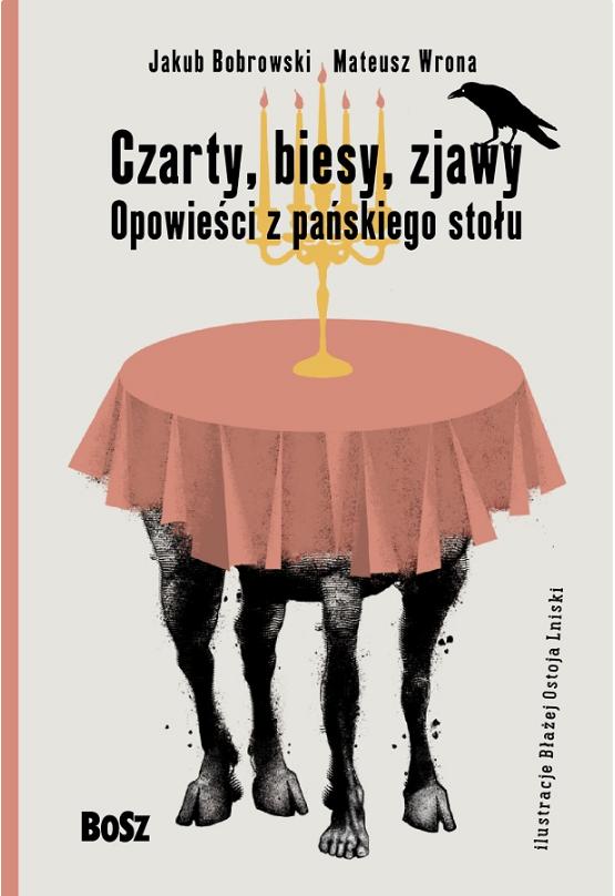 """Okładka do książki wydawnictwa Bosz """"Czarny, biesy, zjawy. Opowieści z pańskiego stołu."""" przestawiająca stół ze świecznikiem. Trzy nogi stołu są zakończone kopytami, czwarta przypomina ludzką nogę."""