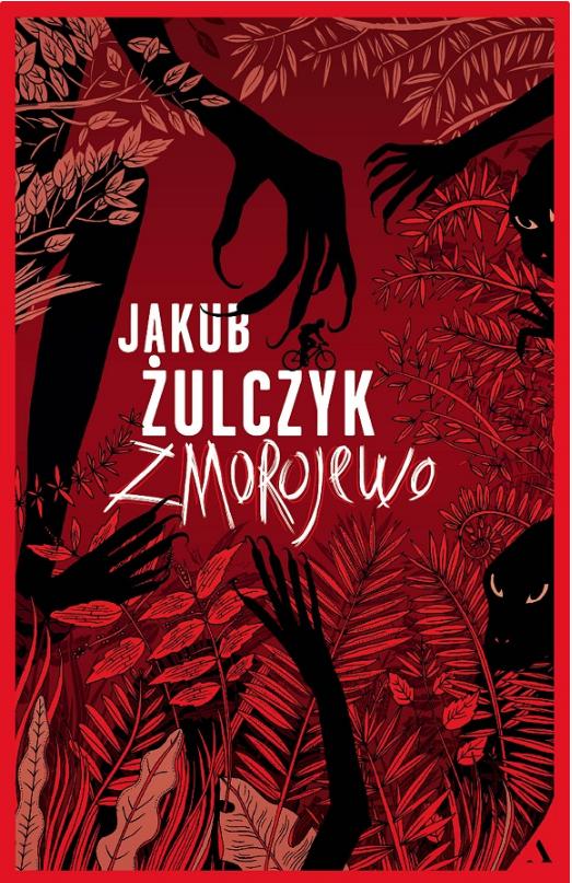 """Okładka do książki """"Zmorojewo"""" zachowana w tonacjach czerwieni i czerni, przedstawiająca las i kryjące się w nim stwory."""